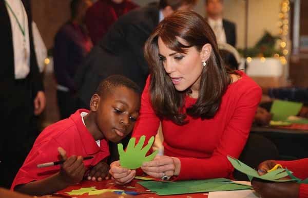 Catherine, Duchess of Cambridge attends the Anna Freud Centre Family School Christmas Party at the Anna Freud Centre on December 15, 2015 in London. The Duchess joined groups of families in festive activities designed to help pupils reflect on the positive progress in their social relationships and communication skills.   AFP PHOTO / POOL / Chris Jackson