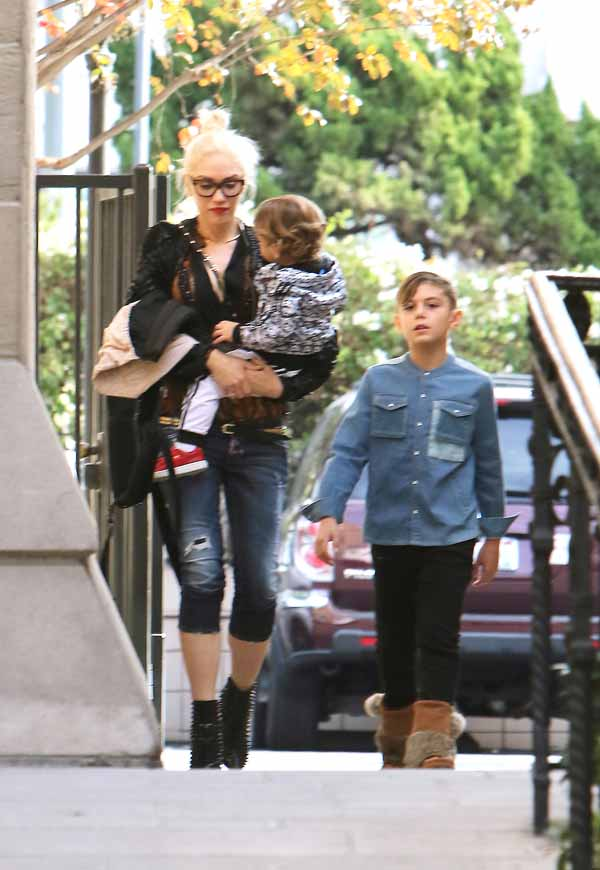Gwen Stefani looks exhausted, wearing black glasses as she arrives at church with sons Apollo and Kingston amid her growing romance with country music star and fellow The Voice coach Blake Shelton. Gwen wears high-heeled studded black and red booties, and skin tight capri blue jeans, and Kingston looks grown-up in a denim button shirt, black jeans and comfy brown boots. Sunday, December 6, 2015. X17online.com