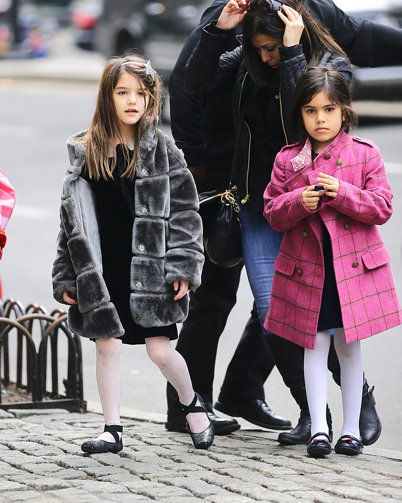 Suri Cruise was spotted heading to a movie theatre with friend and her parents after school in New York City. <P> Pictured: Suri Cruise <P><B>Ref: SPL717749  130314  </B><BR/> Picture by: Sharpshooter Images / Splash<BR/> </P><P> <B>Splash News and Pictures</B><BR/> Los Angeles:310-821-2666<BR/> New York:212-619-2666<BR/> London:870-934-2666<BR/> <span id=