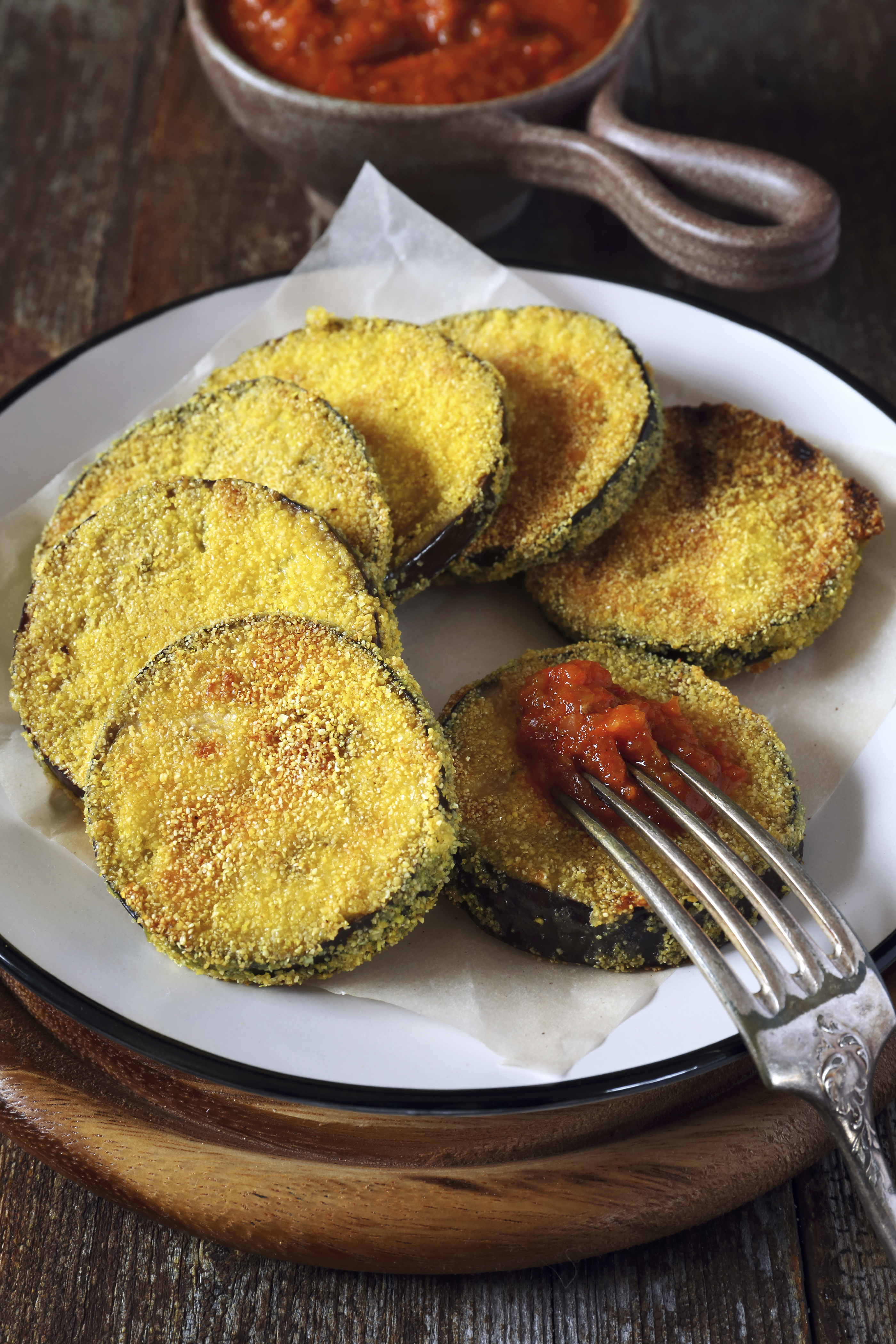 Fried breaded eggplant with tomato sauce