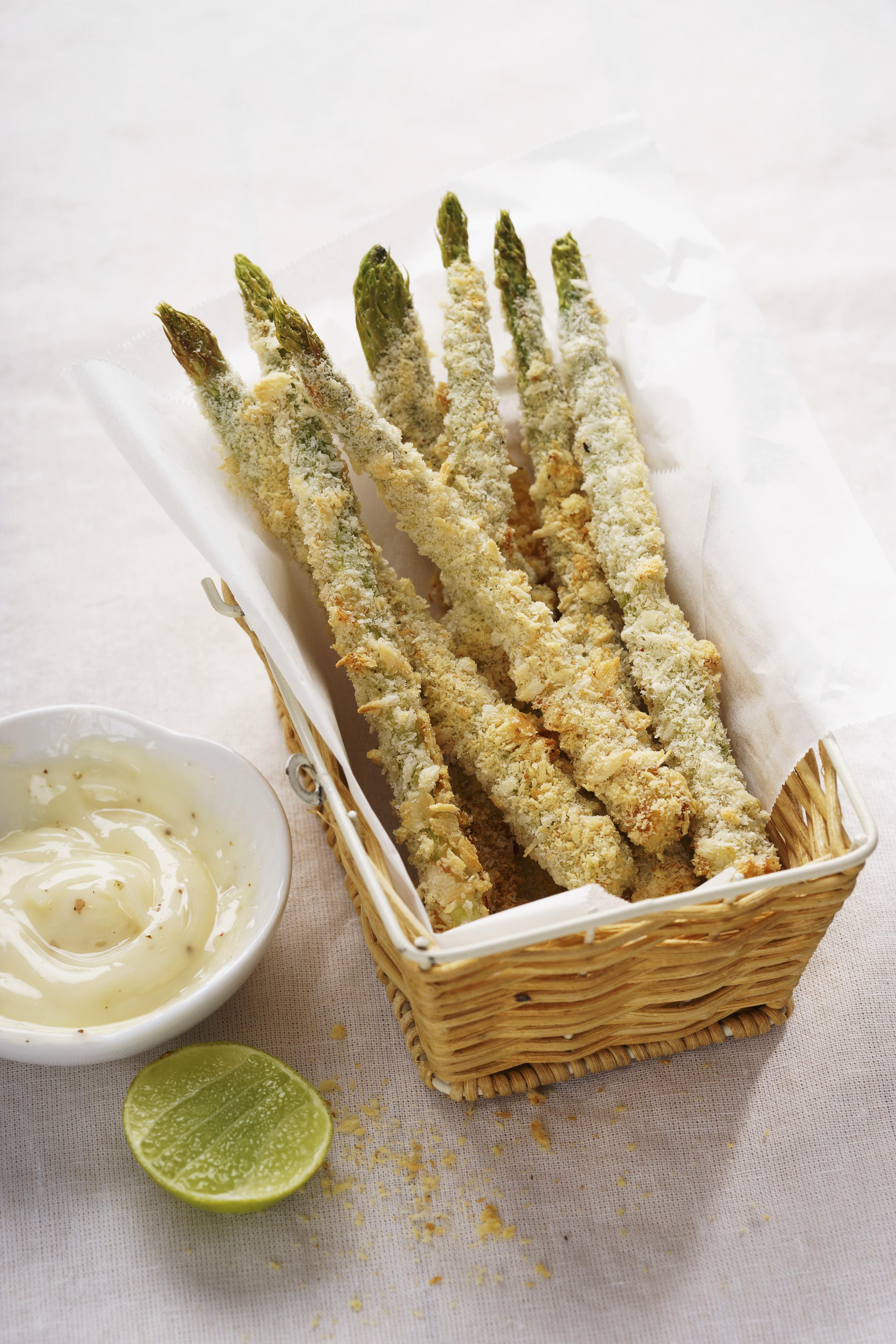 Crunchy baked asparagus fries with mayonnaise dip, healthy vegetable snack