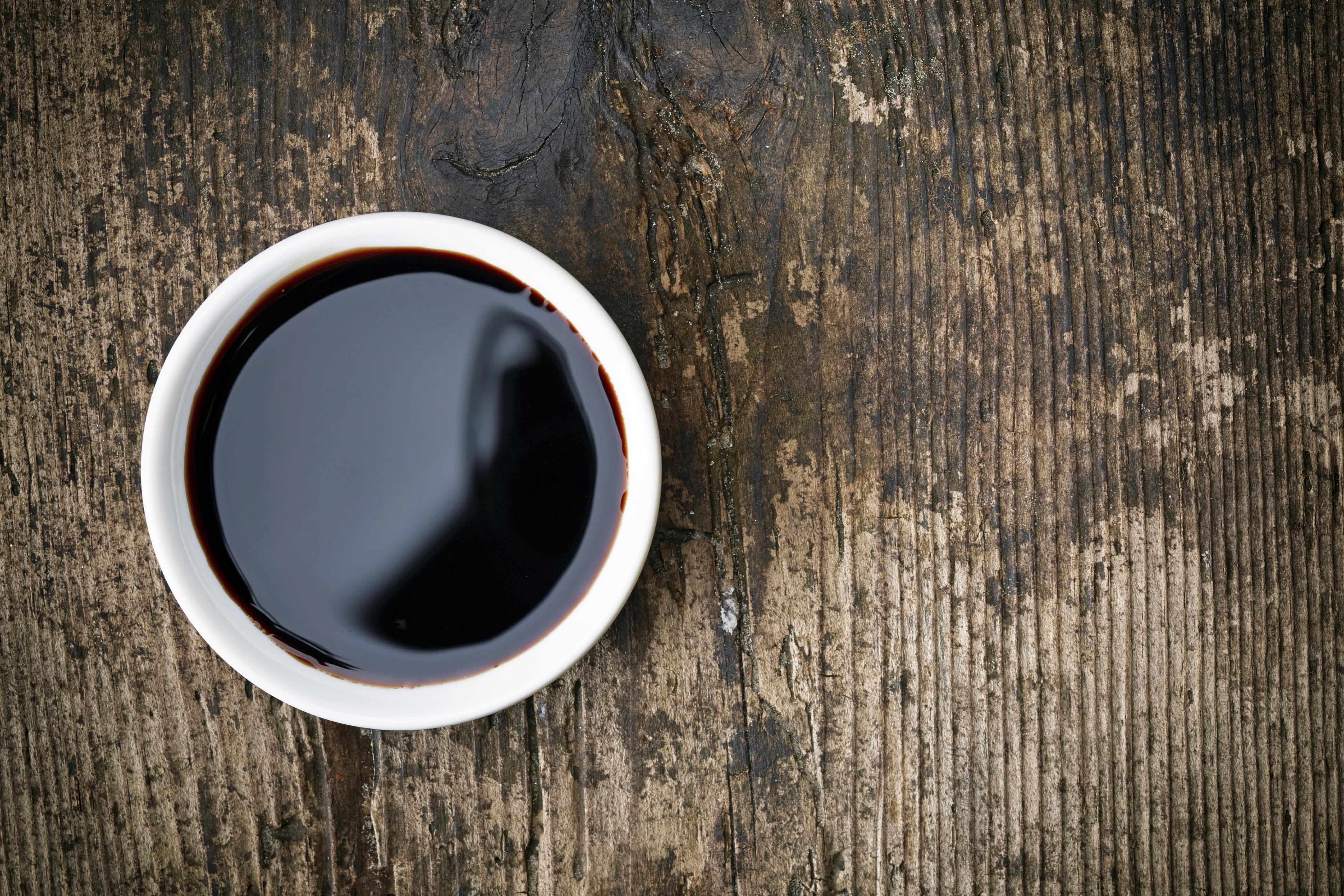 Bowl of Balsamic vinegar on wooden table
