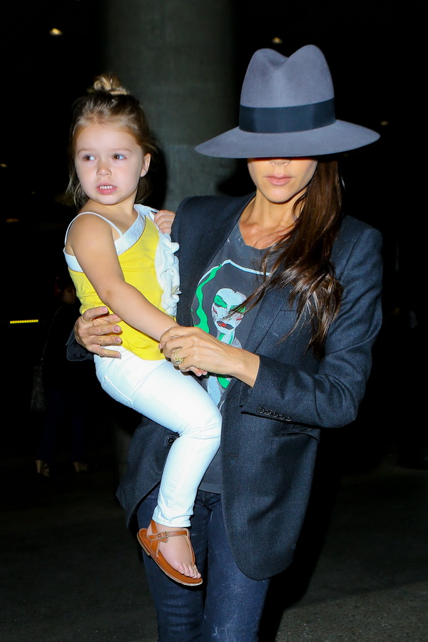 Victoria Beckham looking sharp with daughter Harper at LAX.  Hubby David dropped them off, and recorded the photographers, recording him. Friday, July 18, 2014 X17online.com