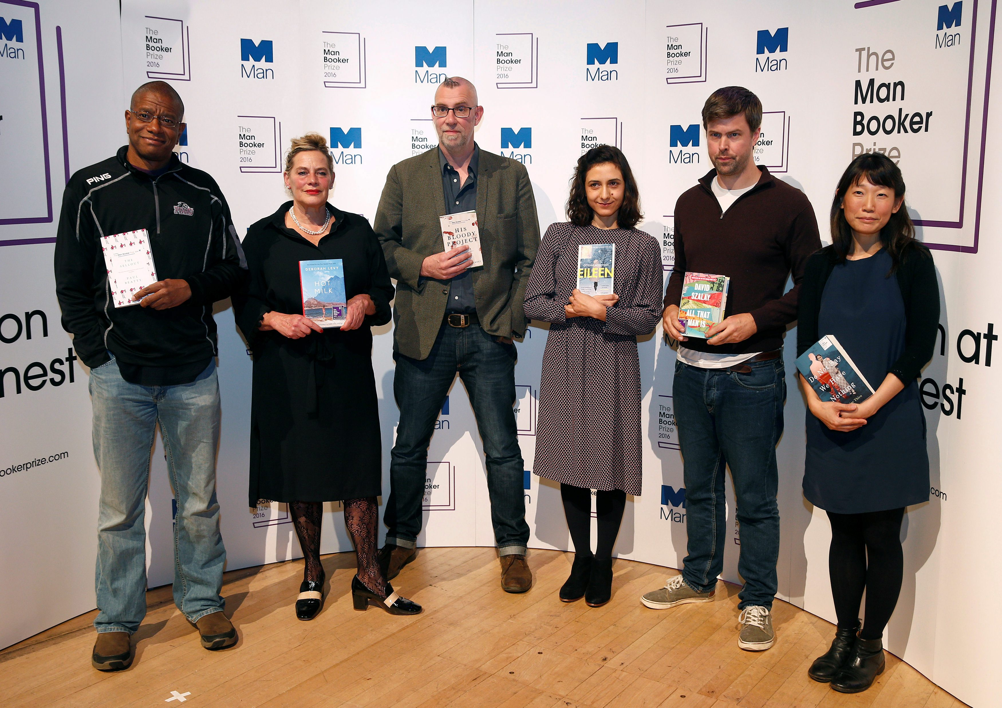 The six Man Booker shortlisted fiction authors, (L to R) Paul Beatty, Deborah Levy, Graeme Macrae Burnet, Ottessa Moshfegh, David Szalay and Madeleine Thien, pose with their books, during a photo-call on the eve of the prize giving in London, Britain October 24, 2016.  REUTERS/Peter Nicholls