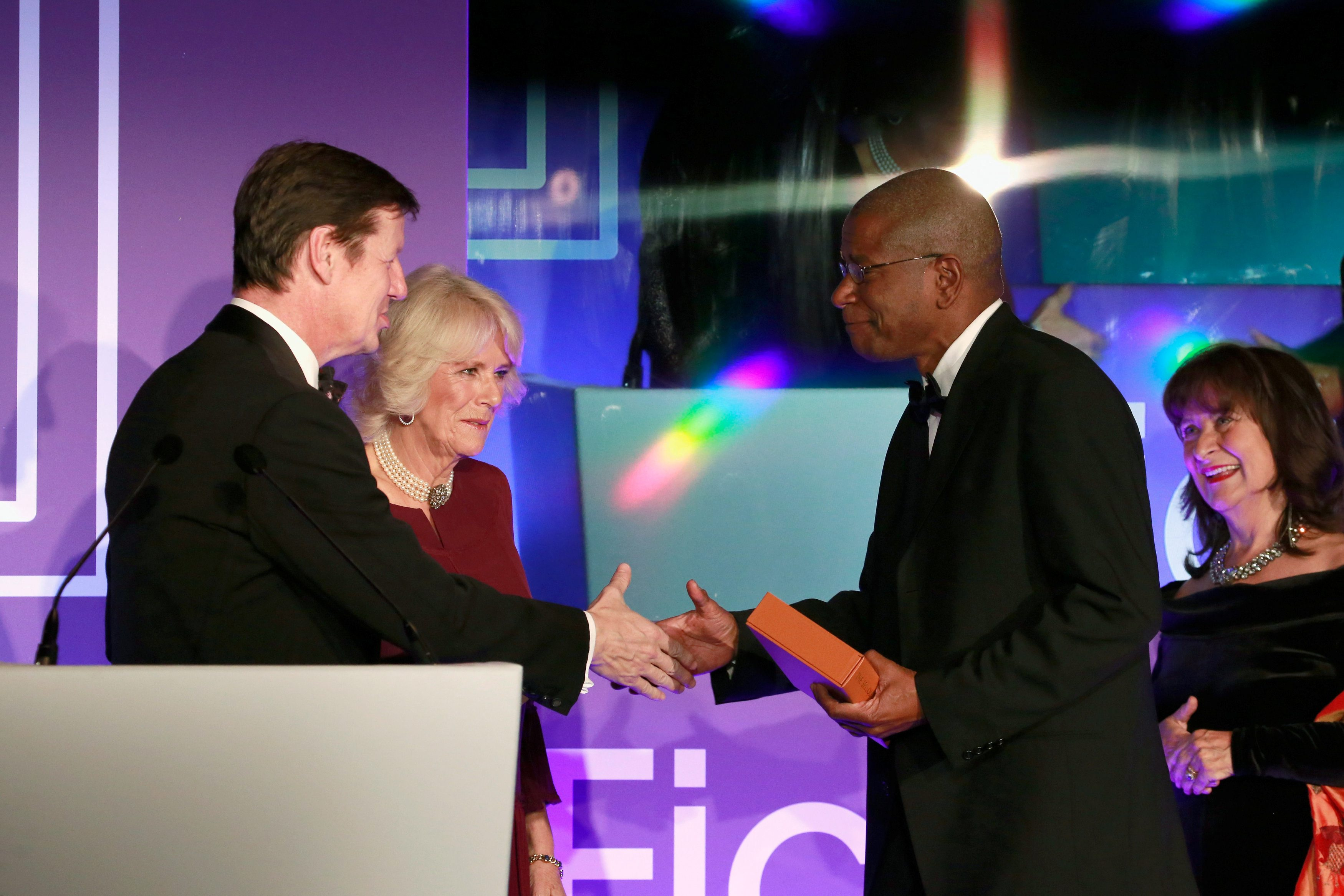 (L-R) Luke Ellis and Camilla, Duchess of Cornwall present shortlisted author Paul Beatty with a copy of his book 'The Sellout ' at the 2016 Man Booker Prize at The Guildhall on October 25, 2016 in London, England. REUTERS/John Phillips/Pool