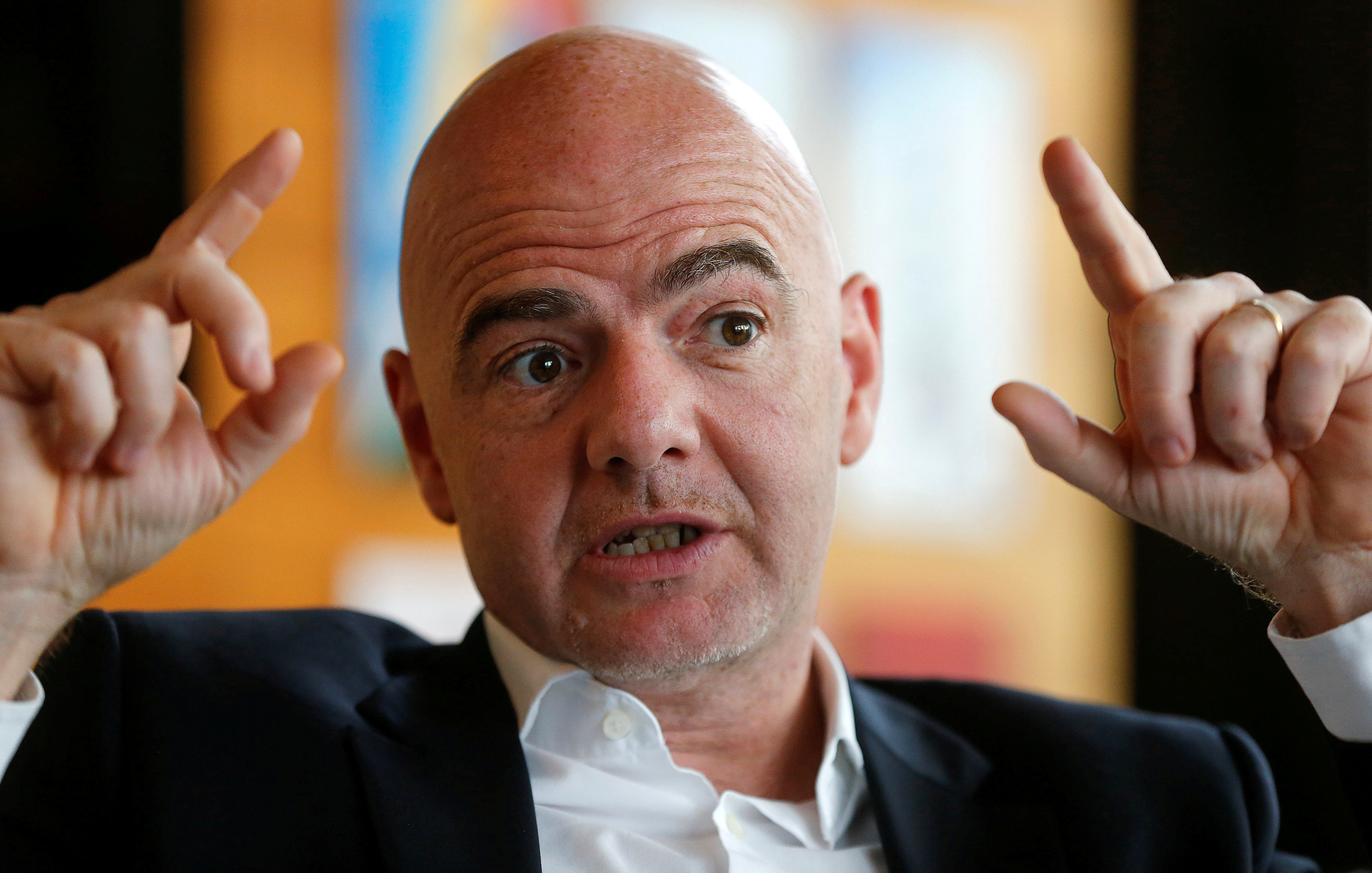 FIFA President Gianni Infantino gestures during an interview with Reuters at the FIFA headquarters in Zurich, Switzerland November 2, 2016. REUTERS/Arnd Wiegmann/File Photo - RTX2RWMI
