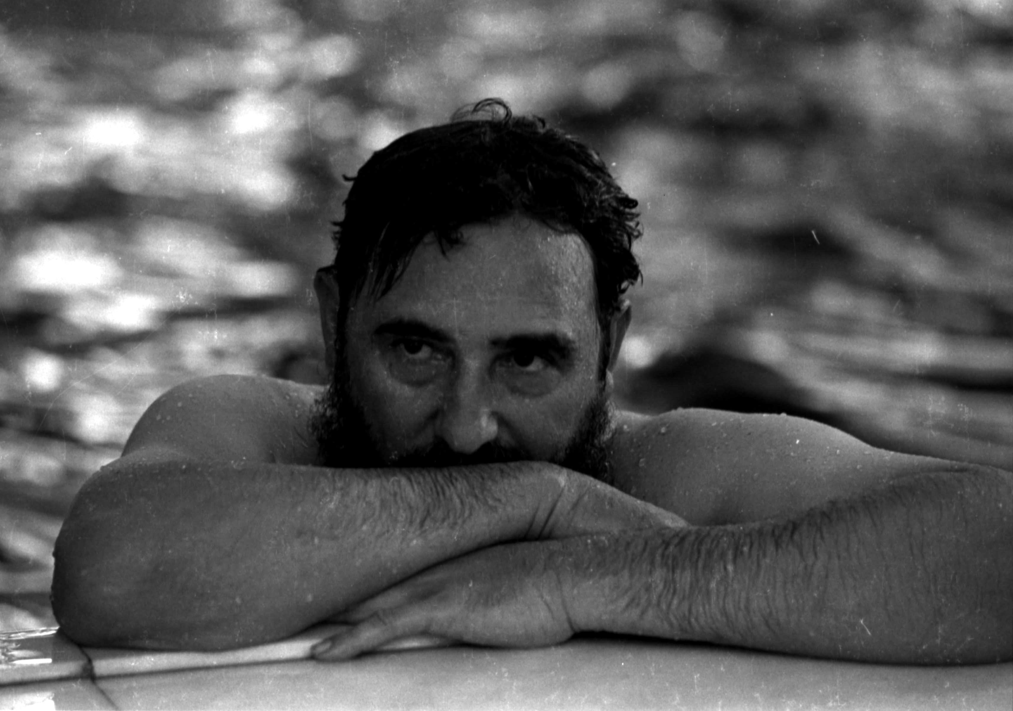 Then Cuban Prime Minister Fidel Castro relaxes in a swimming pool during a visit to Romania in this May 28, 1972 file photo. REUTERS/Prensa Latina/File Photo