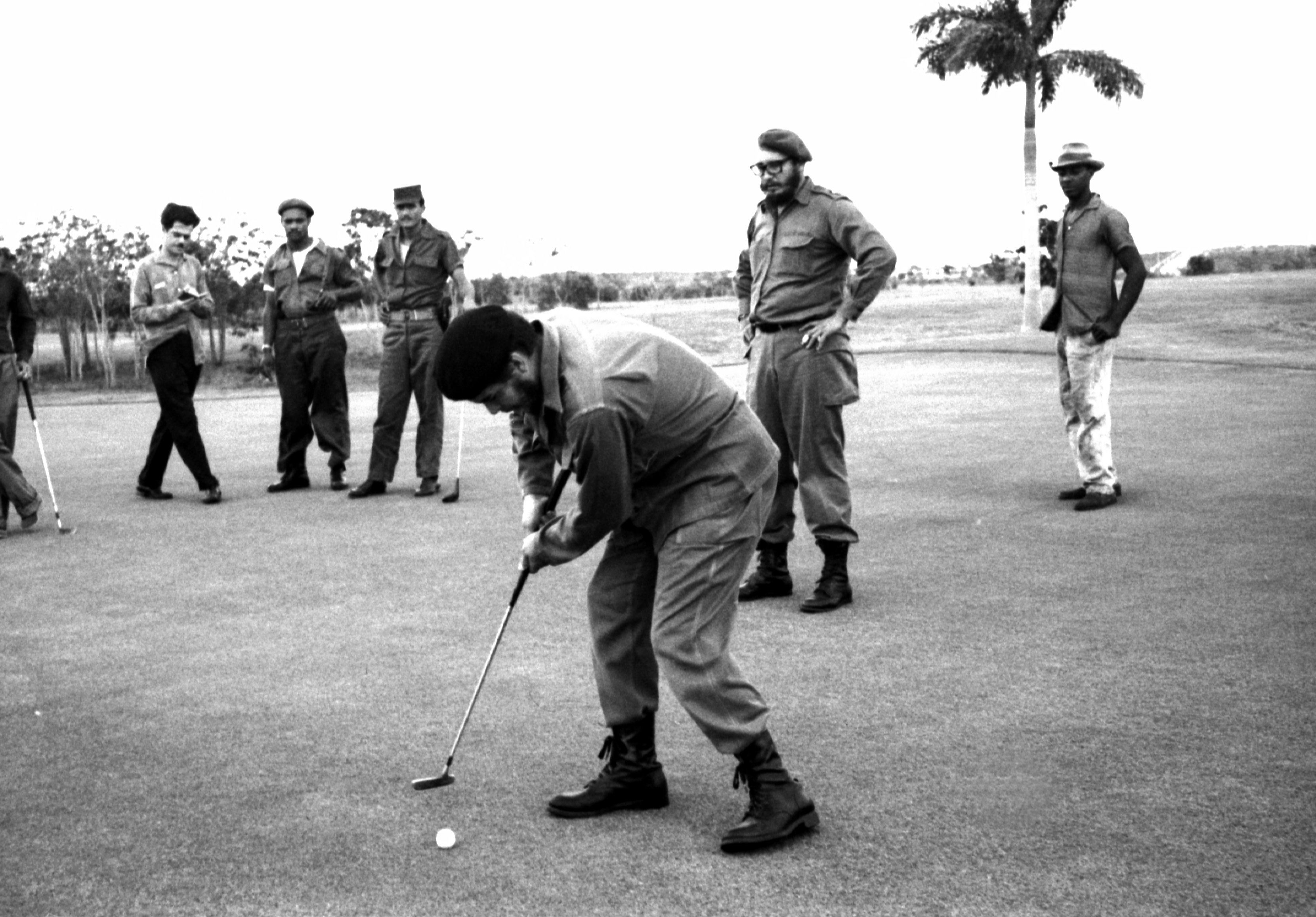 Ernesto Che Guevara (front) plays golf as Fidel Castro stands behind him at Colina Villareal in Havana in this undated file photo. REUTERS/Prensa Latina/File Photo