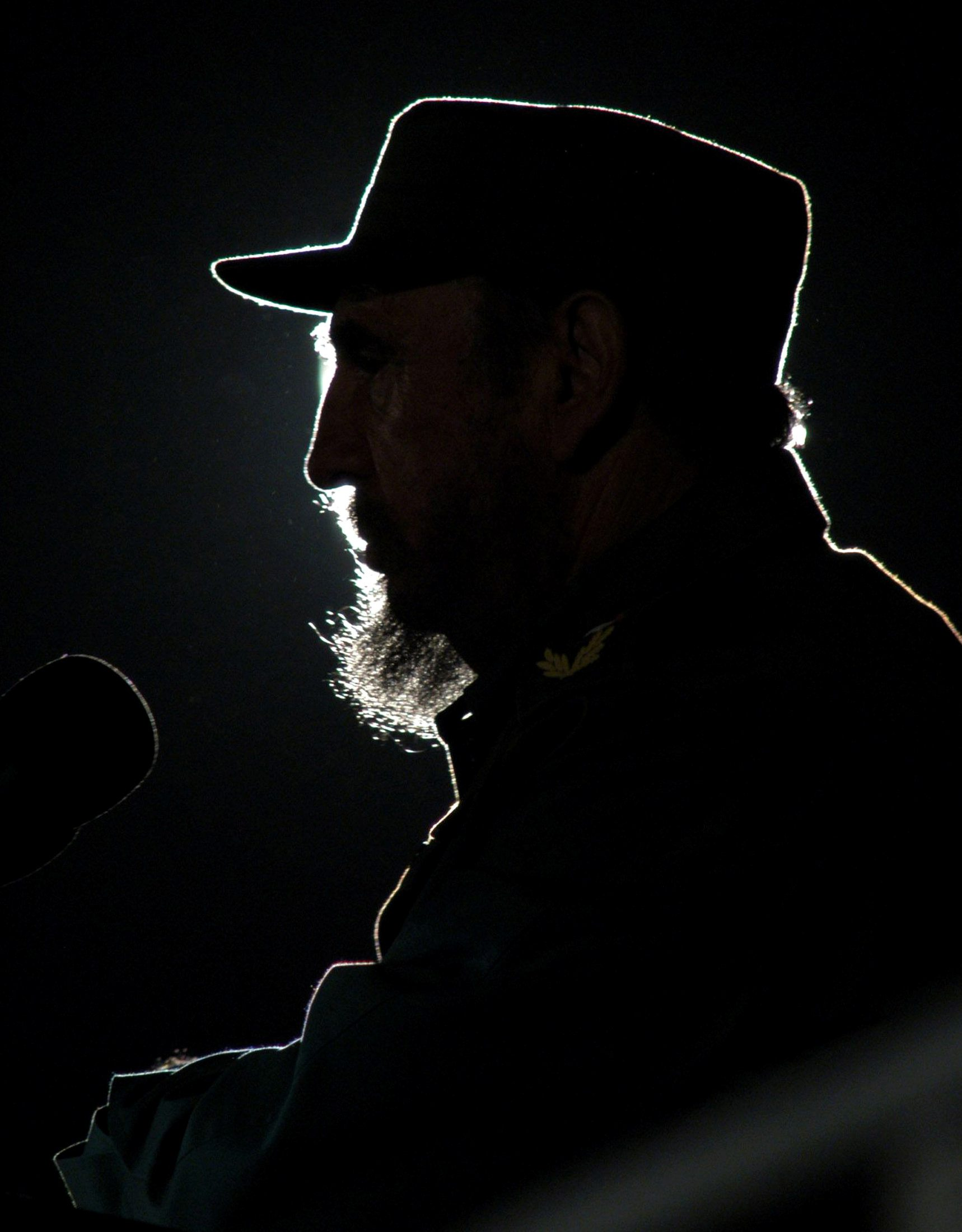 Then Cuban President Fidel Castro addresses the audience during an event with his Venezuelan counterpart Hugo Chavez on Havana's Revolution Square in this February 3, 2006 file photo. REUTERS/Stringer/File Photo