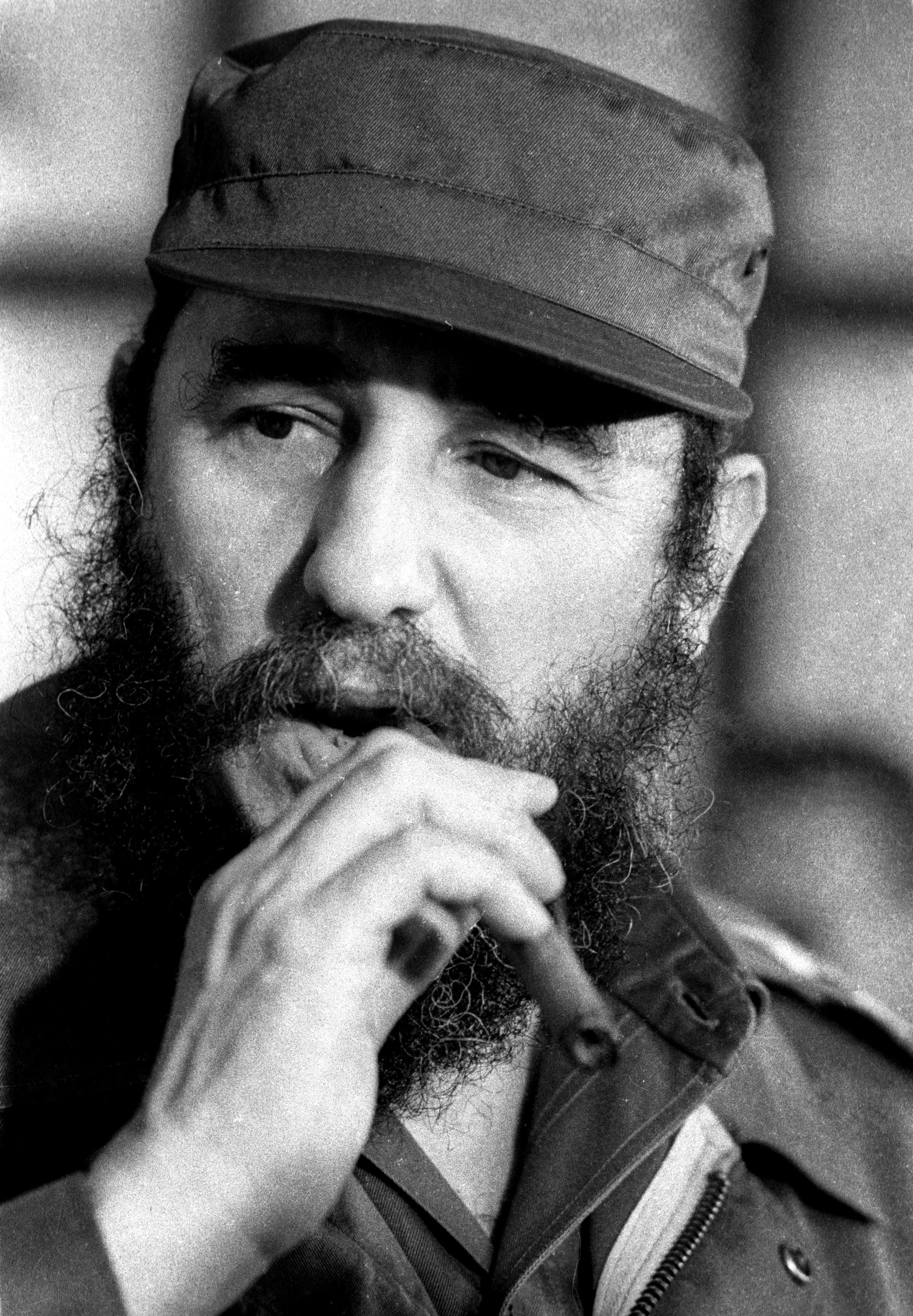 Then Cuban President Fidel Castro smokes a cigar during a meeting of the National Assembly in Havana, in this December 2, 1976 file photo. REUTERS/Prensa Latina/File Photo