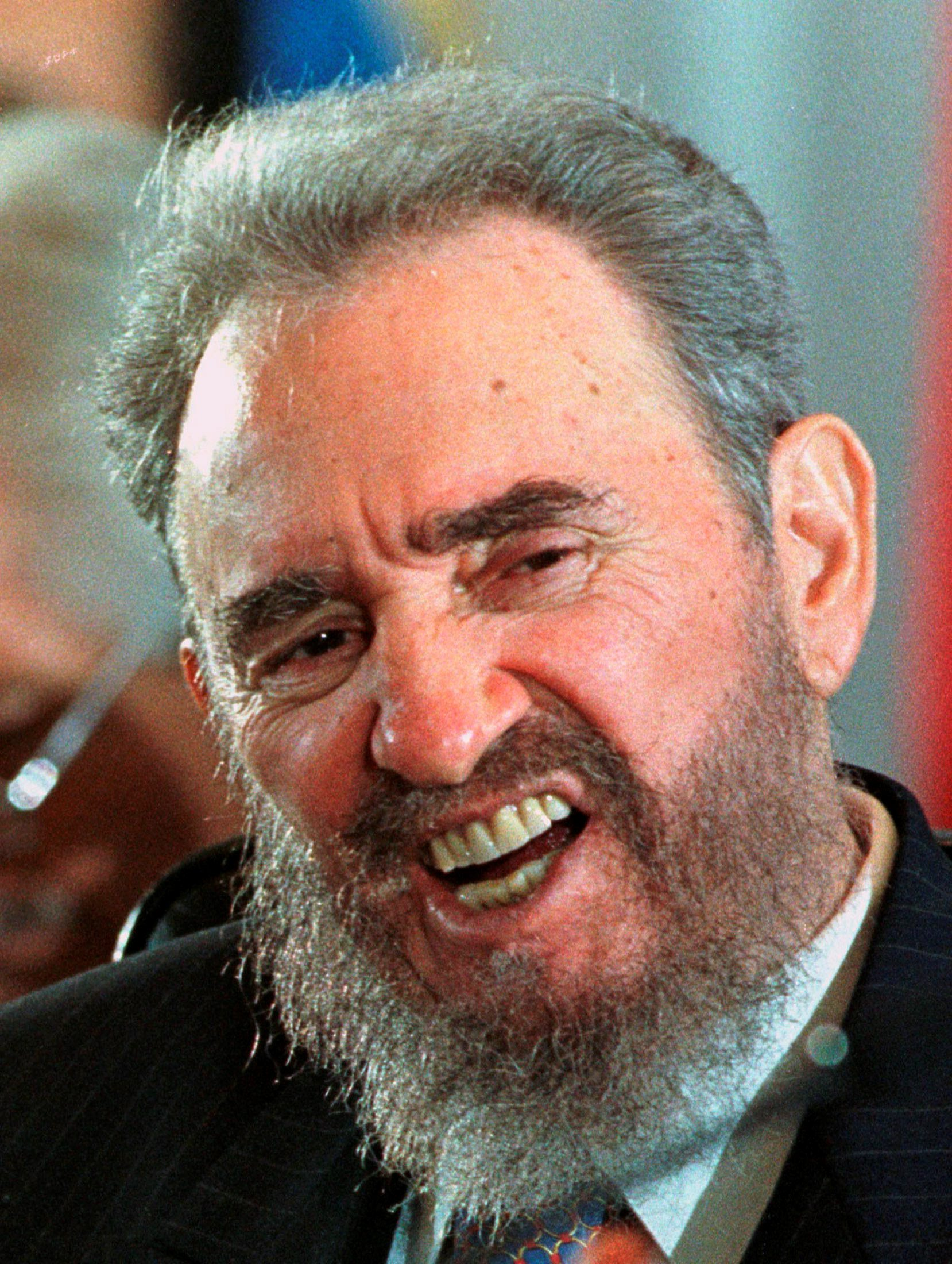 Then Cuban President Fidel Castro fights a yawn on the first day of the VII Ibero-American summit on Margarita Island in this November 8, 1997 file photo. REUTERS/Andrew Winning/File Photo