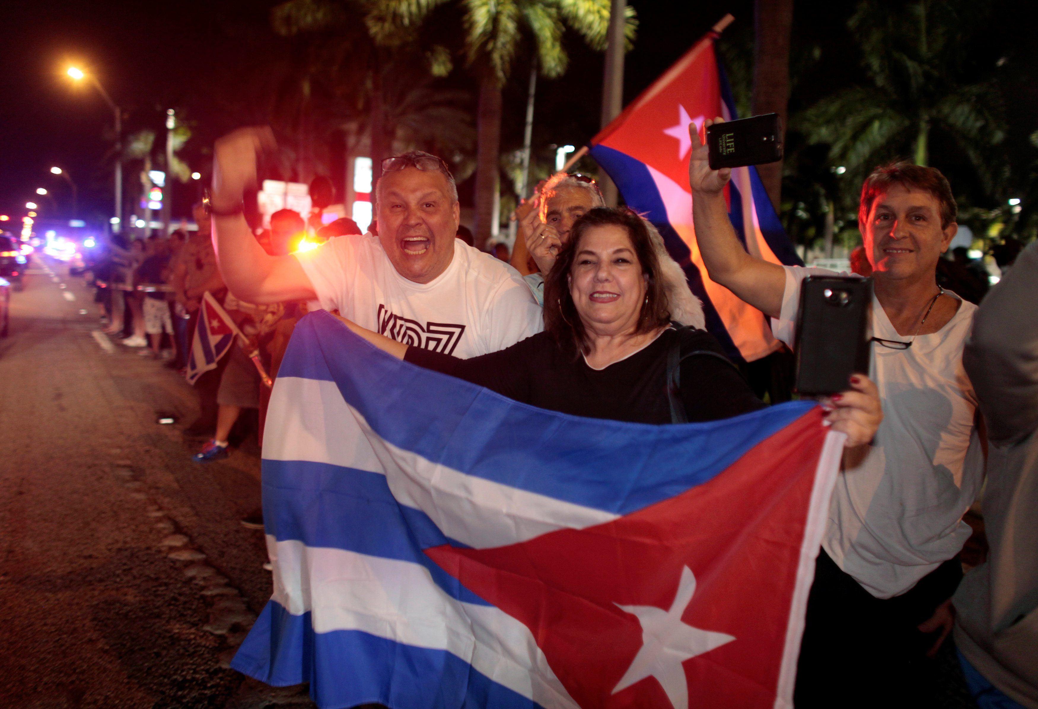 People celebrate after the announcement of the death of Cuban revolutionary leader Fidel Castro, in the Little Havana district of Miami, Florida, U.S. November 26, 2016. REUTERS/Javier Galeano