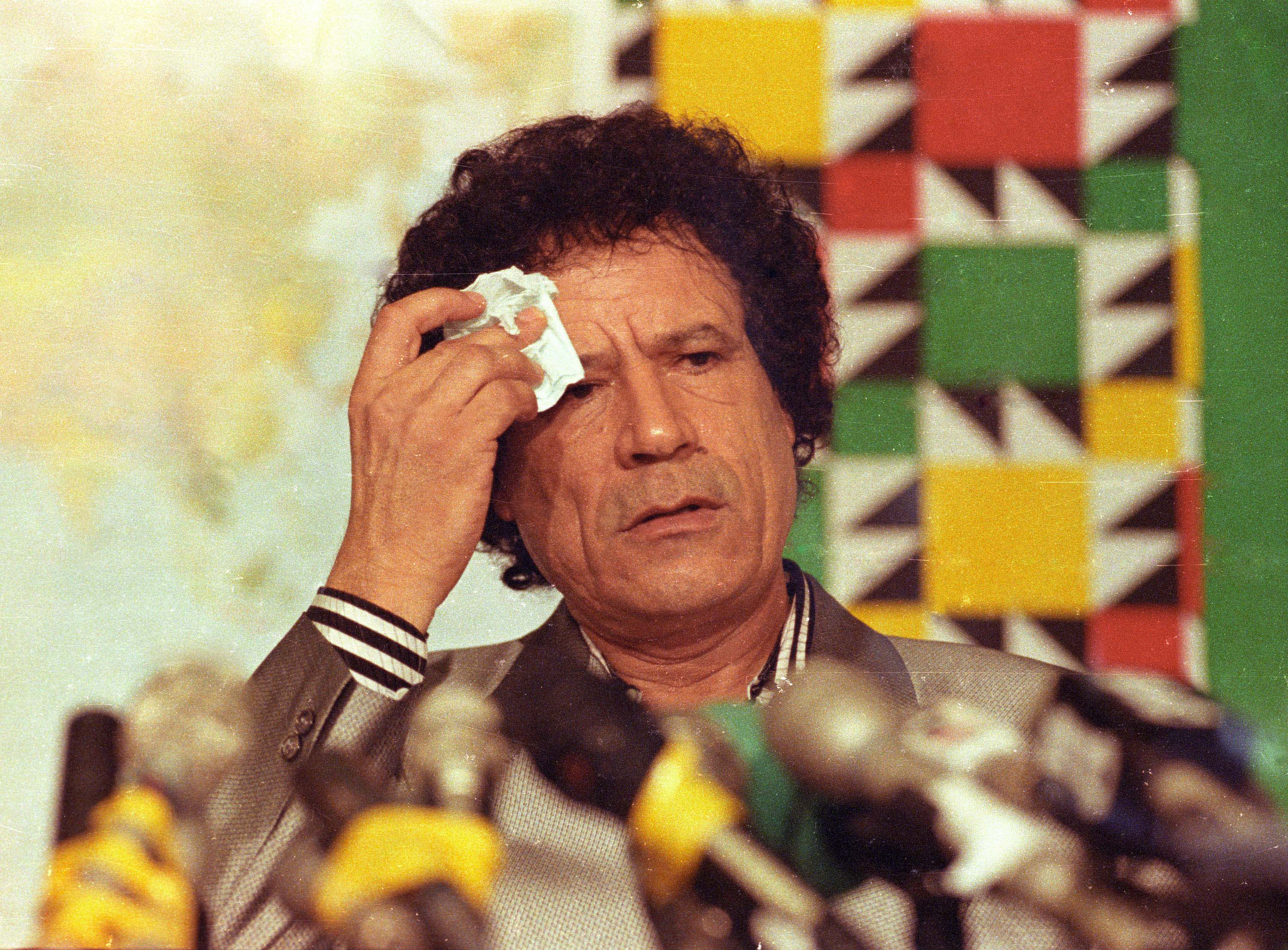 Libyan leader Colonel Muammar Gaddafi wipes his brow during a press conference held at Al Azizia in Tripoli August 20, 1990. Colonel Gaddafi denounced the U.S. blocade on Iraq and threatened to withdraw from the United Nations organization. Reuters/Charles Platiau   BEST QUALITY AVAILABLE - RTR2IZ0Q
