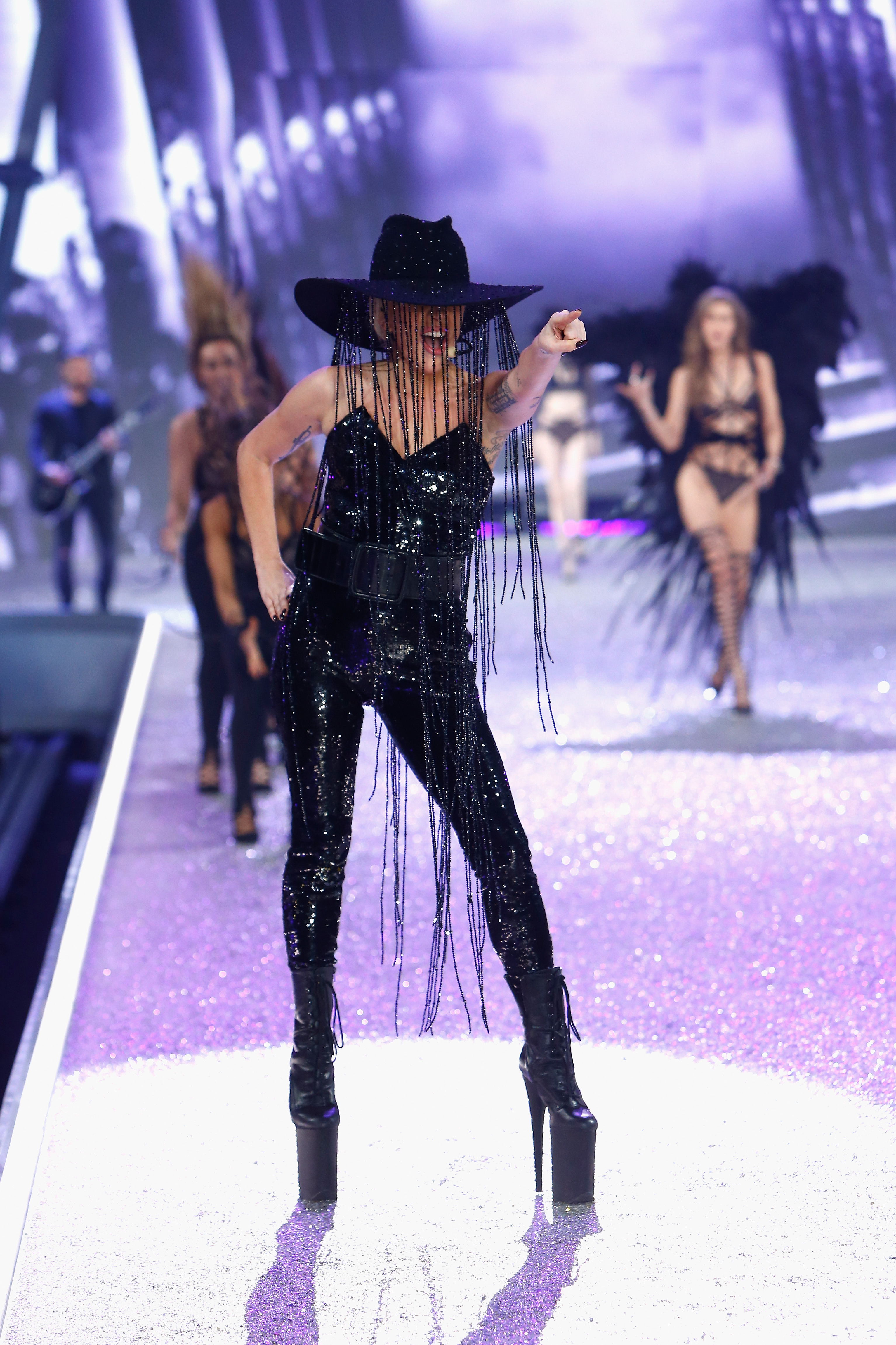 PARIS, FRANCE - NOVEMBER 30:  Lady Gaga performs on the runway with Swarovski crystals during Victoria's Secret Fashion Show on November 30, 2016 in Paris, France.  (Photo by Julien M. Hekimian/Getty Images for Swarovski)