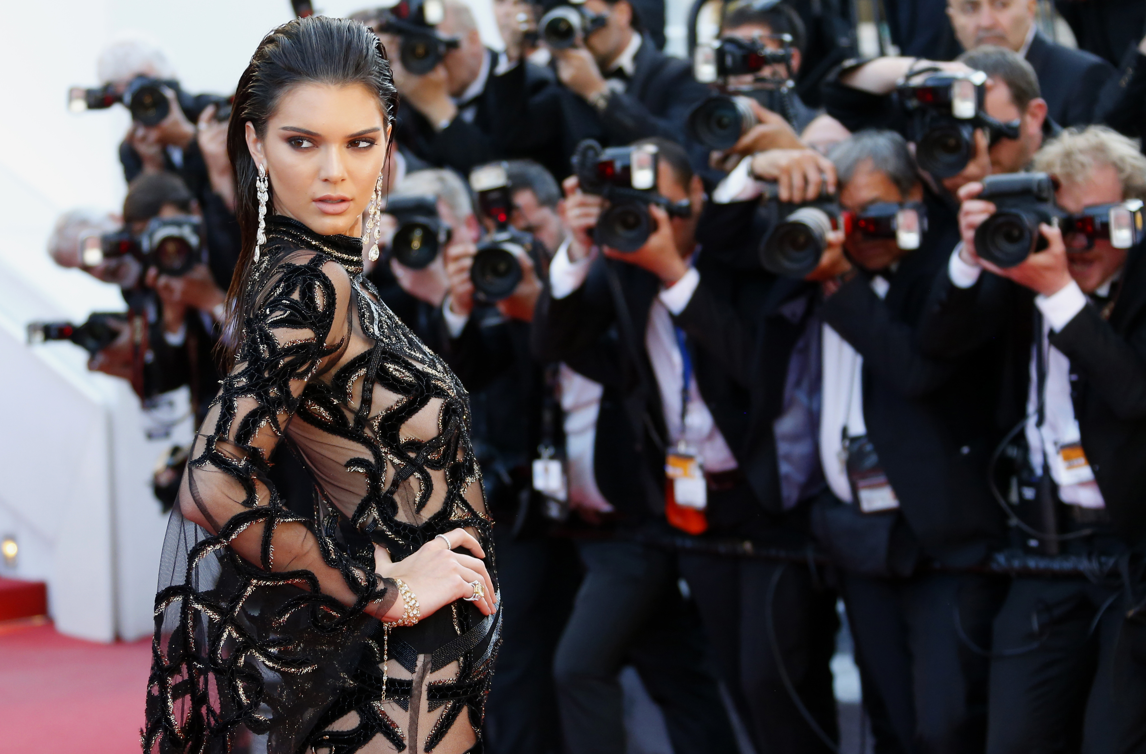 Model Kendall Jenner poses on the red carpet as she arrives for the screening of the film