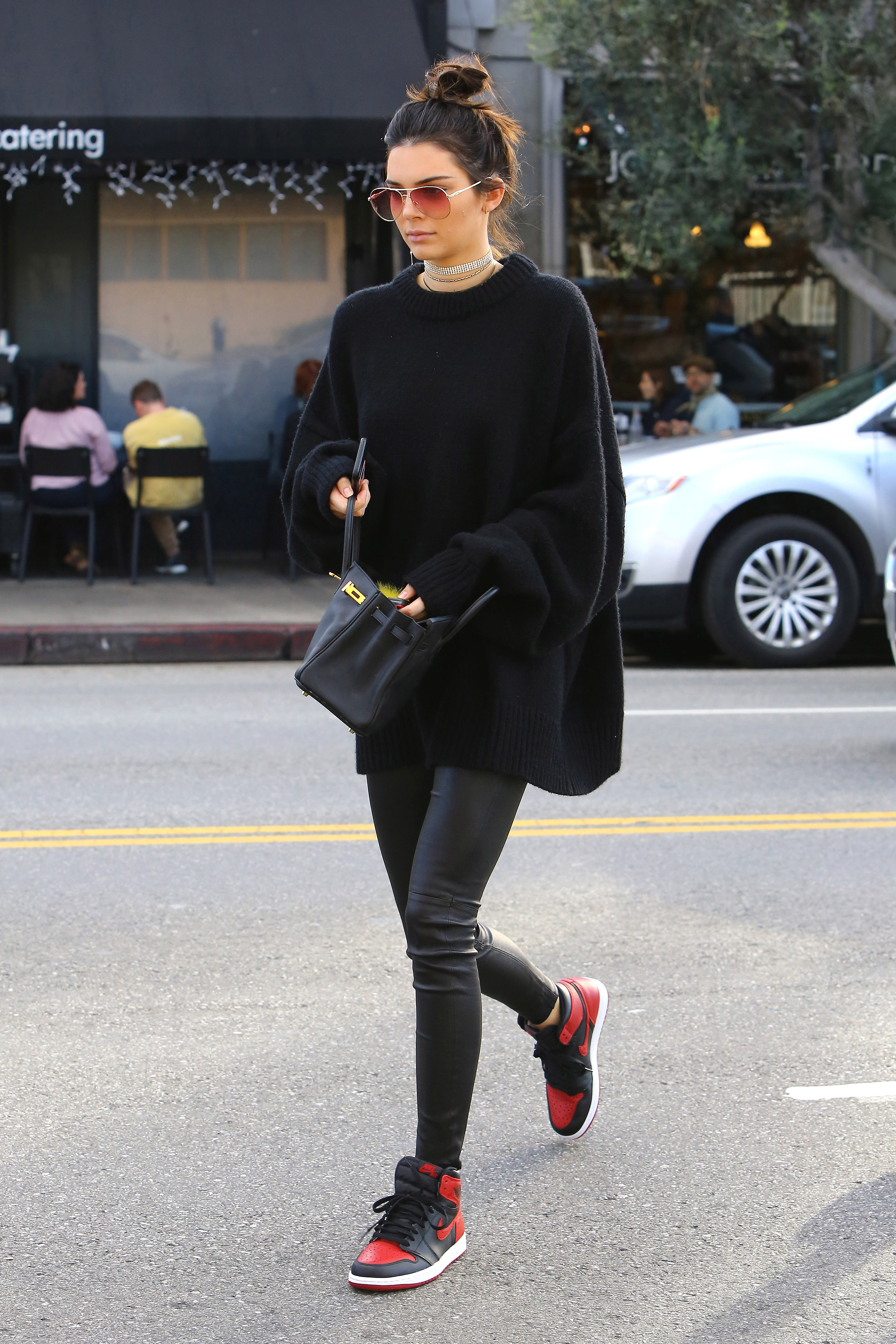 West Hollywood, CA - Kendall Jenner pays a visit to Joan's on Third. The brunette model is wearing leather leggings and an oversized knit sweater paired with Nike sneakers and a layered chokers.        December 22, 2016, Image: 309340243, License: Rights-managed, Restrictions: , Model Release: no, Credit line: Profimedia, AKM-GSI