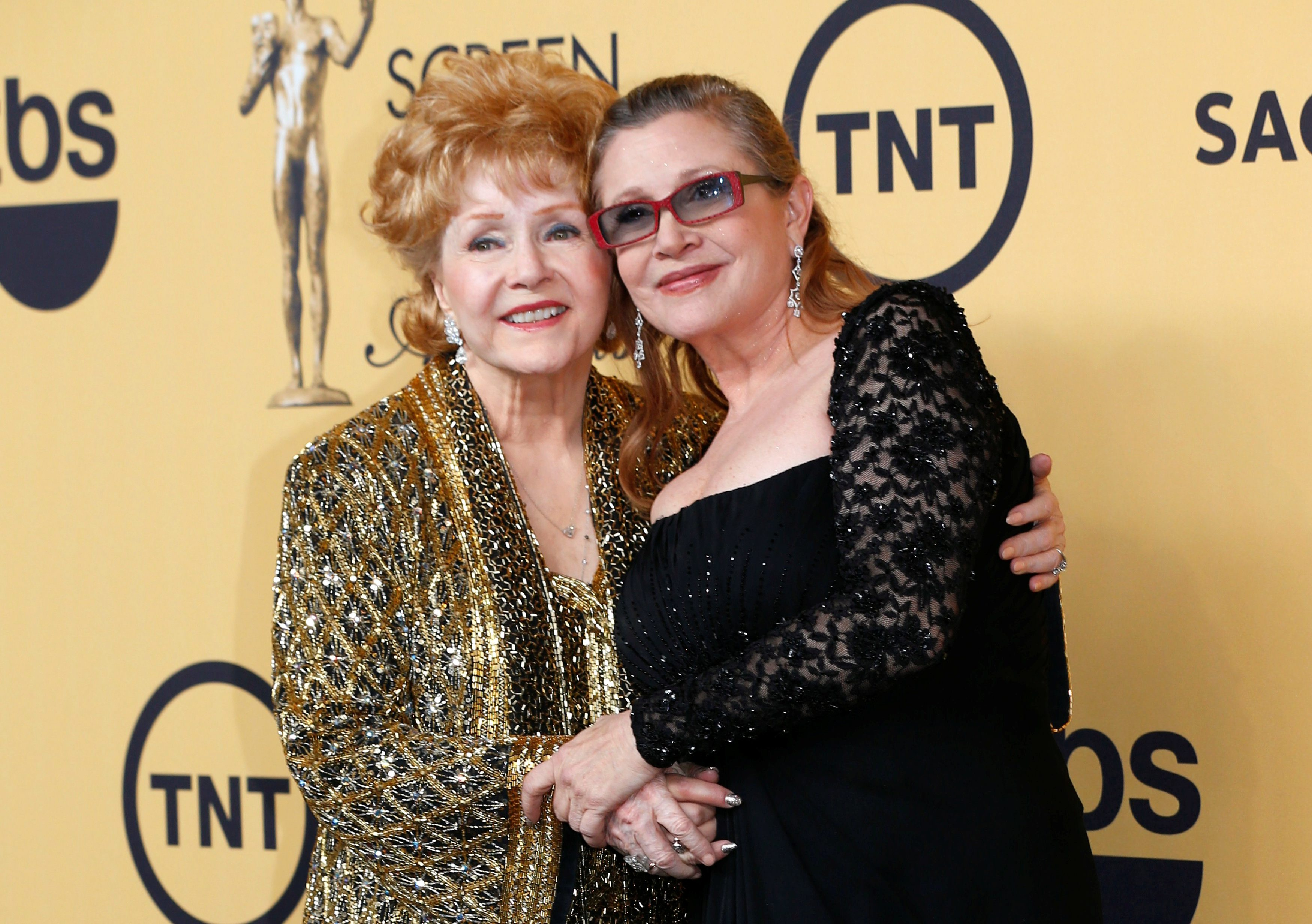 FILE PHOTO: Actress Debbie Reynolds poses with her daughter actress Carrie Fisher backstage after accepting her Lifetime Achievement award at the 21st annual Screen Actors Guild Awards in Los Angeles, California January 25, 2015.  REUTERS/Mike Blake/File Photo