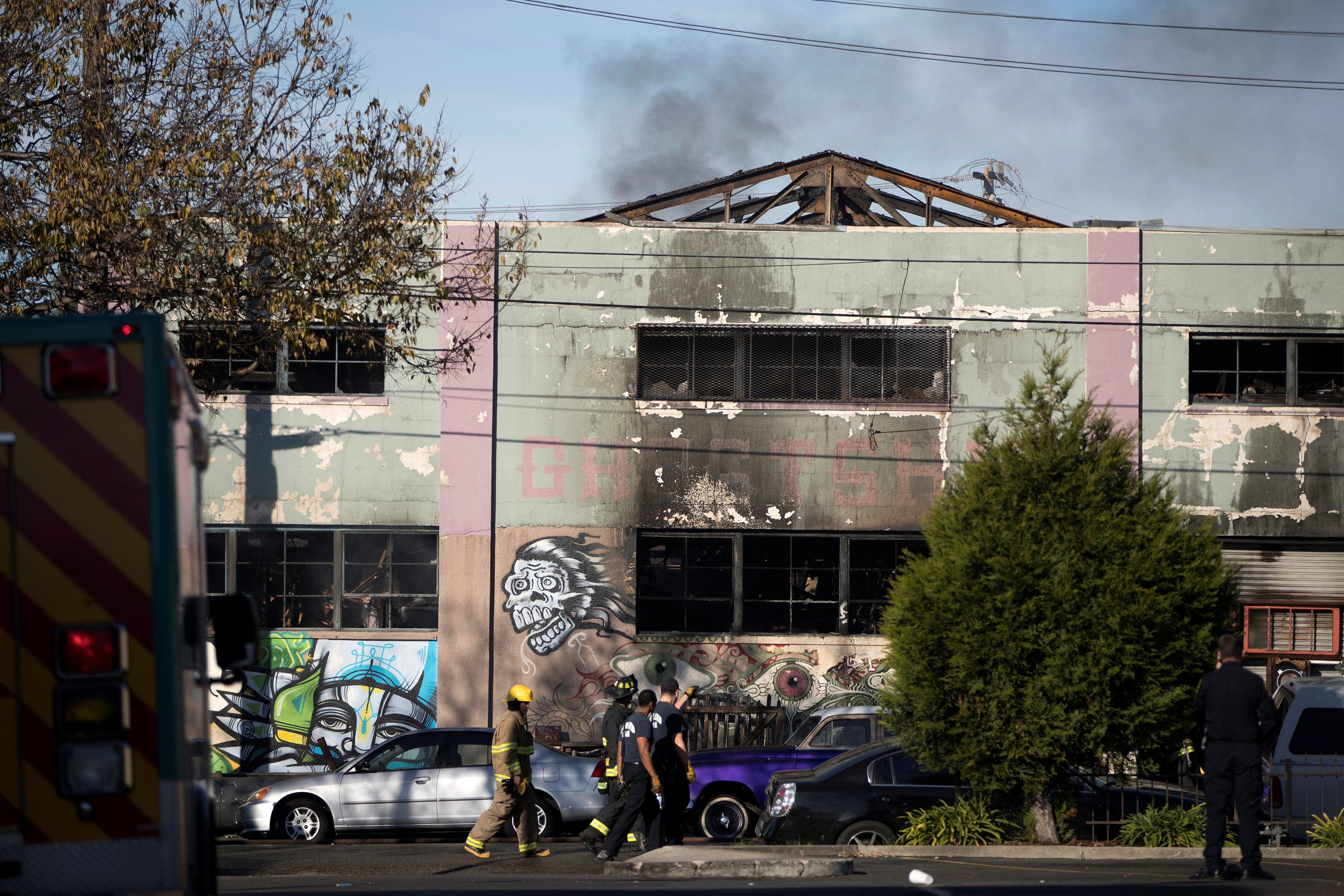 Smoke rises from a smoldering building where a fire broke out during an electronic dance party late Friday evening, resulting in at least nine deaths and many unaccounted for in the Fruitvale district of Oakland, California, U.S. December 3, 2016. REUTERS/Stephen Lam