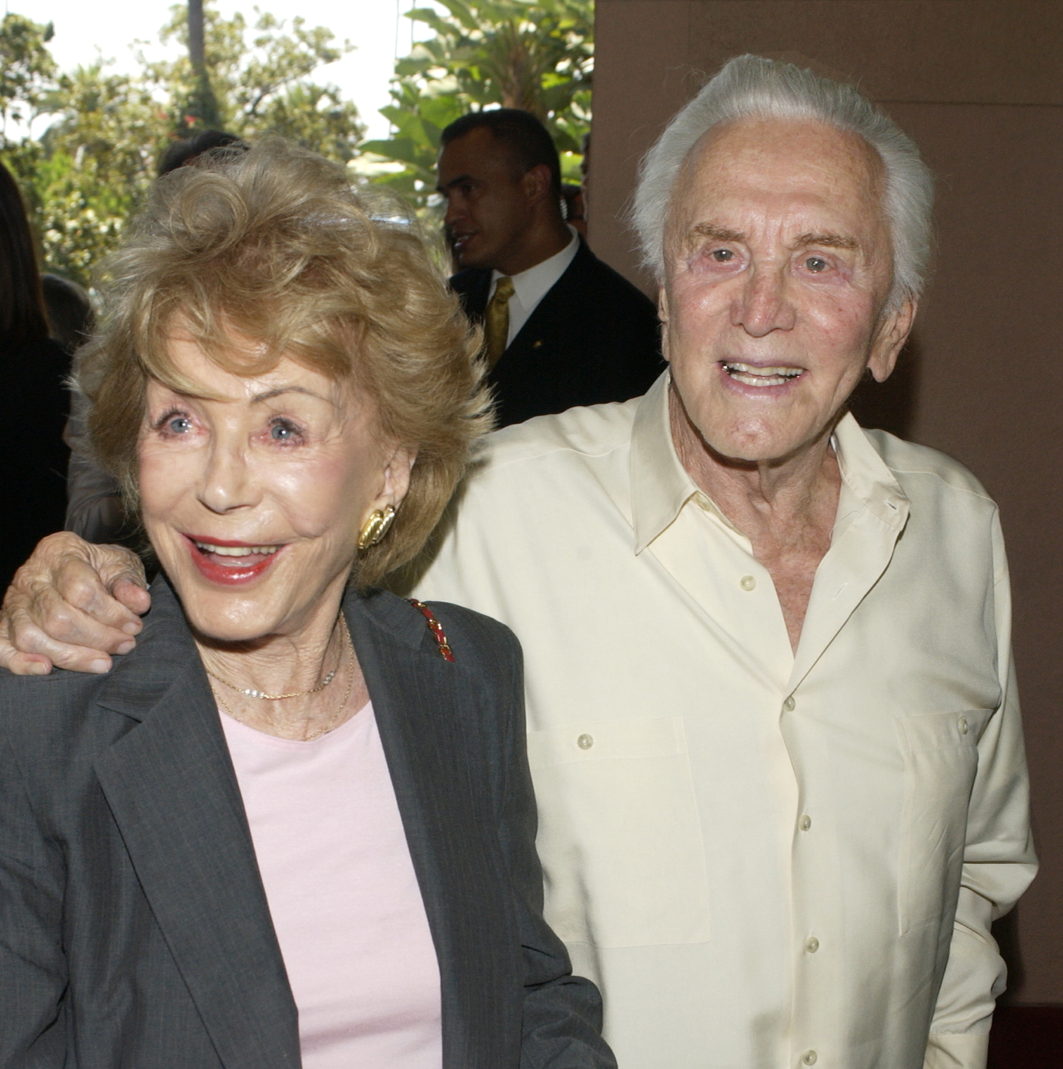 Actor Kirk Douglas (R) and his wife Anne arrive for Hollywood Foreign Press Association annual installation luncheon in Beverly Hills, California, August 11, 2004. - RTXMT7F