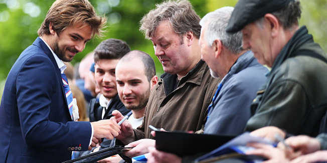 LONDON, ENGLAND - APRIL 25:  Niko Kranjcar of QPR signs autographs prior to the Barclays Premier League match between Queens Park Rangers and West Ham United at Loftus Road on April 25, 2015 in London, England.  (Photo by Clive Rose/Getty Images)