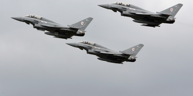Typhoon jets fly over RAF Coningsby, central England, July 11, 2007. The planes were on display as it was announced by the RAF that they will  take up a role to become responsible for protecting southern UK airspace from potential September 11 style attacks.     REUTERS/Darren Staples      (BRITAIN) - RTR1RQ7K