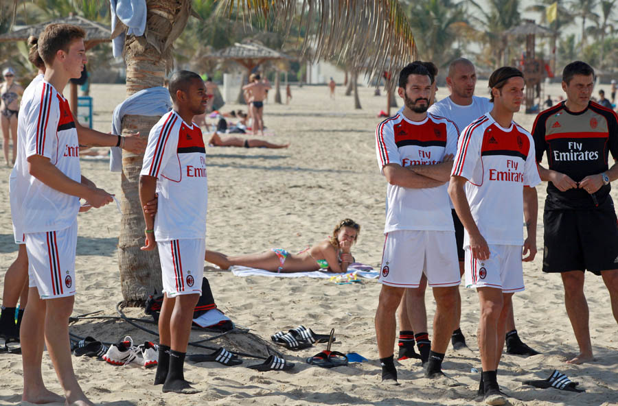 AC Milan players wait for the start of a training session at Al-Mamzar Beach in the Gulf emirate of Dubai on December 31, 2011. The Italian champions will face Qatar-backed French club Paris Saint-Germain in the Challenge Cup on January 4, 2012. AFP PHOTO/STR