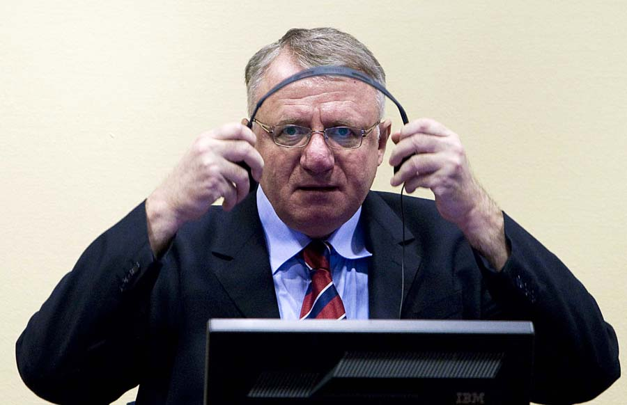 FILE - In this March 6, 2009 file photo Serbian ultranationalist leader Vojislav Seselj seen in court at the International Criminal Tribunal for the former Yugoslavia (ICTY) in The Hague, Netherlands. Seselj, 58, is to start making his closing arguments on Wednesday, March 14, 2012. Seselj has been charged with crimes against Muslims and Croats, allegedly committed by the volunteers recruited by his party during 1991-1995 war that followed the breakup of the former Yugoslavia. (AP Photo/Valerie Kuypers, Pool, File)