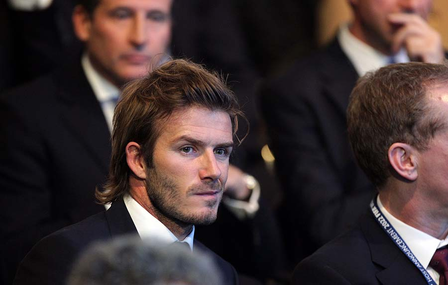 Vice-President England 2018 David Beckham sits following the official announcement of the 2018 World Cup host country on December 2, 2010 at the FIFA headquarters in Zurich. Russia and the tiny Gulf state of Qatar were awarded the 2018 and 2022 World Cups today after an acrimonious bidding war marred by allegations of corruption and illegal deal-making.  AFP PHOTO / SEBASTIAN DERUNGS