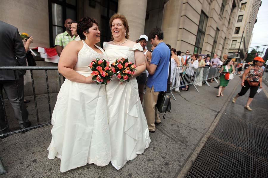 NEW YORK, NY - JULY 24: Barbara Tremblay (L) and Stacey Minondo wait on line to get married at the Brooklyn City Clerk's office on July 24, 2011 in New York City.Today was the first day gay couples were allowed to legally marry in New York state after Gov. Andrew Cuomo signed the historic legislation into law.   Mario Tama/Getty Images/AFP== FOR NEWSPAPERS, INTERNET, TELCOS & TELEVISION USE ONLY ==