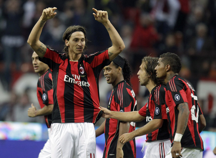 AC Milan forward Zlatan Ibrahimovic celebrates after scoring with his teammates, midfielder Kevin Prince Boateng, of Ghana, right, midfielder Andrea Pirlo, second from right, and Brazilian forward Ronaldinho, during a Serie A soccer match between AC Milan and Genoa at the San Siro staium in Milan, Italy, Saturday, Sept. 25, 2010. (AP Photo/Luca Bruno)