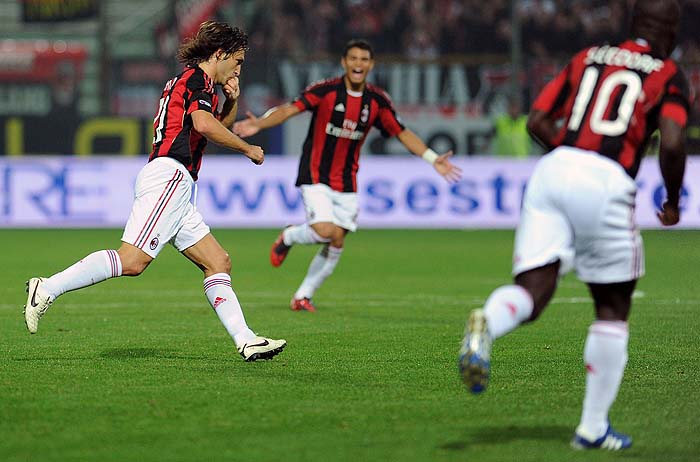 A.C. Milan's midfielder Andrea Pirlo (L) celebrates after scoring during their Italian serie A football match between Parma Fc and AC Milan at the Ennio Tardini stadium in Parma on October 2, 2010.  AFP PHOTO / ALBERTO PIZZOLI