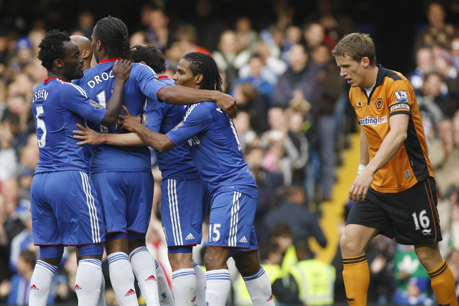 Chelsea's Florent Malouda, center no. 15, celebrates scoring against Wolverhampton Wanderers with teammates during their English Premier League soccer match at Stamford Bridge, London, Saturday, Oct. 23, 2010. (AP Photo/Sang Tan) ** NO INTERNET/MOBILE USAGE WITHOUT FOOTBALL ASSOCIATION PREMIER LEAGUE (FAPL) LICENCE - CALL +44 (0)20 7864 9121 or EMAIL info@football-dataco.com FOR DETAILS **