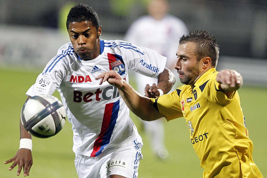 Lyon's Michel Bastos of Brazil, left, challenges for the ball with Sochaux's David Sauget, right, during their French League One soccer match at Gerland stadium, in Lyon, central France, Saturday, Oct. 30, 2010. (AP Photo/Laurent Cipriani)