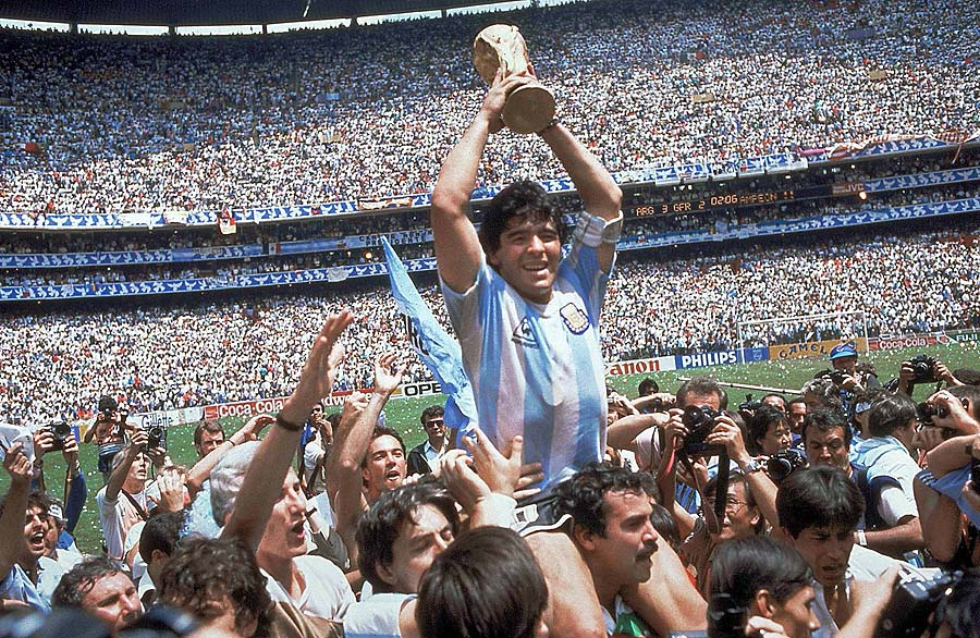 **  FILE  ** Argentina's Diego Maradona, holding up the trophy, is carried on shoulders as he celebrates at the end of the World Cup soccer final game against West Germany at the Atzeca Stadium, in Mexico City, in this June 29, 1986, file photo. Argentina won 3-2. Maradona and Argentinean coach Carlos Bilardo have been asked to lead Argentina by Julio Grondona, head of the Argentine Football Association, Tuesday, Oct. 28, 2008. (AP Photo/Carlo Fumagalli, file)