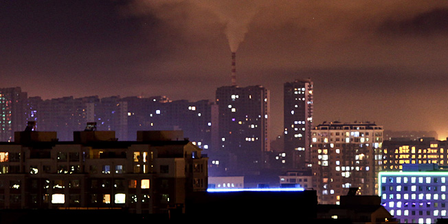 In this Wednesday Sept. 1, 2010 photo, a chimney of a coal-fired power plant emit smoke during the night in Changchun in northeast China's Jilin province. As the world's biggest greenhouse gas producer, China was widely seen as an obstacle in the Copenhagen climate summit last year. But while negotiations inched forward, Beijing poured $34.6 billion into clean energy in 2009, nearly double the U.S. investment. (AP Photo) CHINA OUT