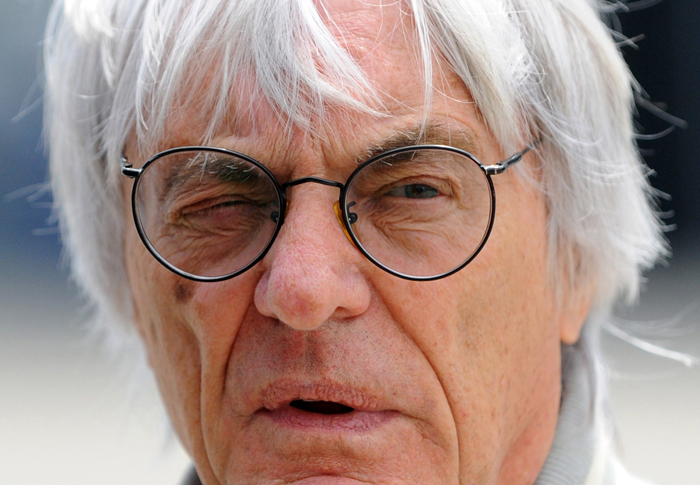 """(FILES) A file picture taken on April 17, 2010, shows Formula One supremo Bernie Ecclestone at the Chinese Grand Prix in Shanghai. Ecclestone suffered a head injury after muggers robbed him of jewellery in London, police said Friday November 26, 2010, just weeks after he said only """"simple"""" people got attacked in the city. Robbers punched and kicked the 80-year-old billionaire to the ground after pouncing on him and his girlfriend Fabiana Flosi, 31, outside the headquarters of his business empire, Formula One Holdings, police said Friday. AFP PHOTO/GOH CHAI HIN/FILES"""