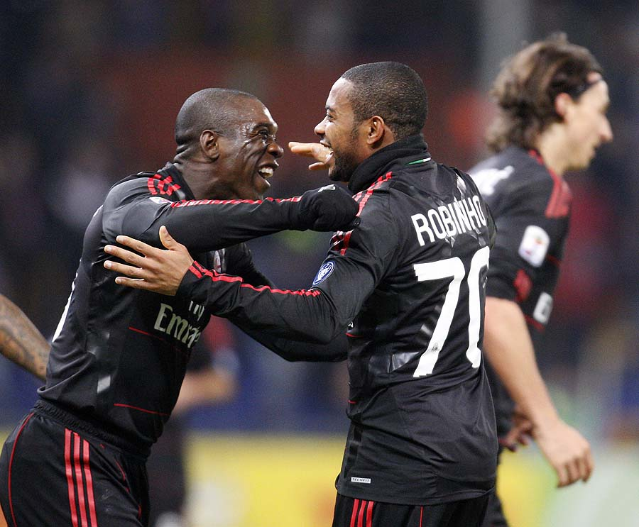 AC Milan Brazilian forward Robinho, right, celebrates with his teammate AC Milan midfielder Clarence Seedorf, of the Netherlands, after scoring during the Serie A soccer match between Sampdoria and AC Milan at the Ferraris stadium in Genoa, Italy, Saturday, Nov. 27, 2010. (AP Photo/Antonio Calanni)