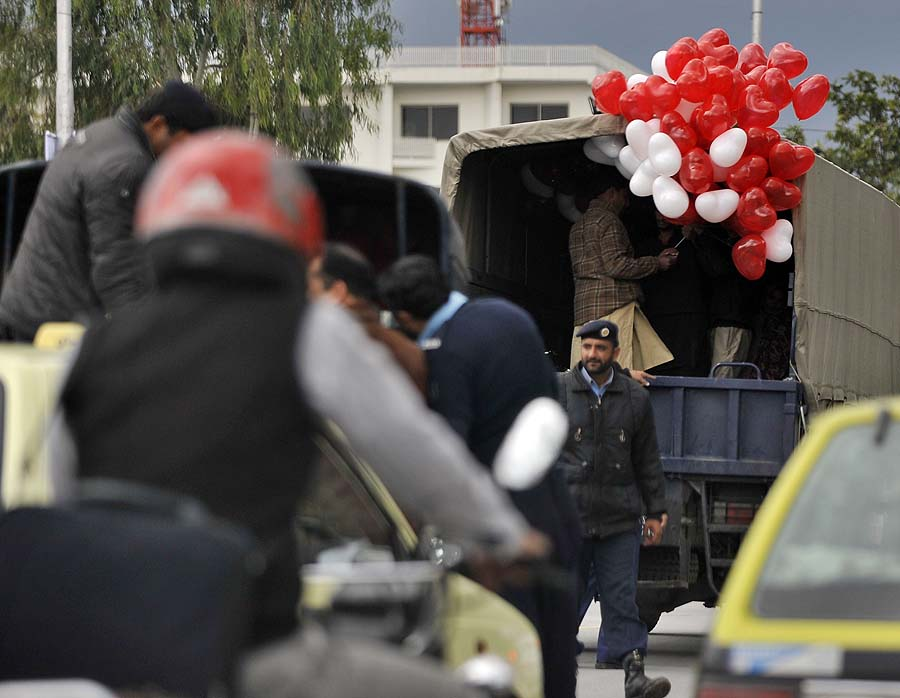 Pakistani police detain street vendors selling balloons on Valentine's Day in Islamabad on February 14, 2011. In Pakistan some extremist groups see the increasing popularity of Valentines Day among the affluent youth as immoral westernisation. AFP PHOTO/ AAMIR QURESHI