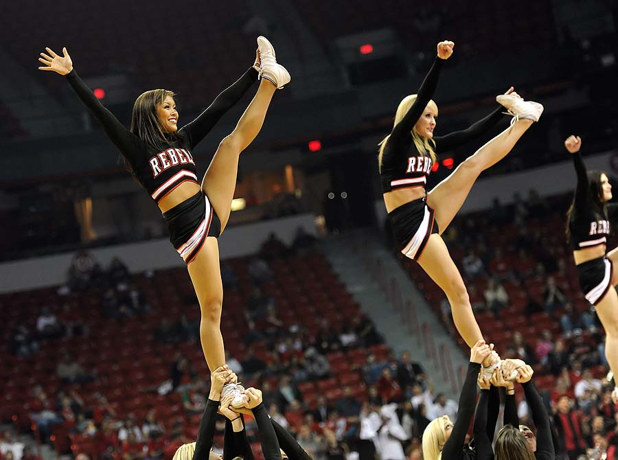 LAS VEGAS, NV - FEBRUARY 15: UNLV Rebels cheerleaders perform during a game against the Air Force Falcons at the Thomas & Mack Center February 15, 2011 in Las Vegas, Nevada. UNLV won 49-42.   Ethan Miller/Getty Images/AFP== FOR NEWSPAPERS, INTERNET, TELCOS & TELEVISION USE ONLY ==