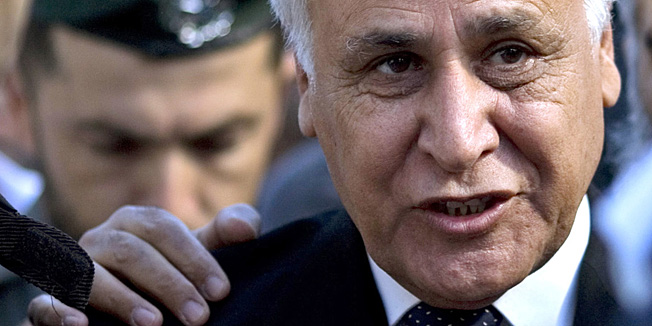 Former Israeli President Moshe Katsav arrives at a court in Tel Aviv, Tuesday, March 22, 2011. An Israeli court sentenced former Israeli President Moshe Katsav to seven years in prison for rape Tuesday, making him the highest-ranking Israeli official ever sent to jail in a case that has riveted the country for nearly five years.  (AP Photo/Ariel Schalit)