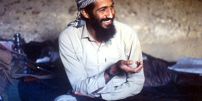 """---EDITORS NOTE--- RESTRICTED TO EDITORIAL USE - MANDATORY CREDIT """"AFP PHOTO / HO / FILES"""" NO MARKETING NO ADVERTISING CAMPAIGNS DISTRIBUTED AS A SERVICE TO CLIENTS(FILES) This file photo taken in 1988 shows Osama bin Laden smiling as he sits in a cave in the Jalalabad region of Afghanistan. Al-Qaeda mastermind Osama bin Laden was killed late on May 1, 2011 in a firefight with covert US forces deep inside Pakistan, prompting President Barack Obama to declare """"justice has been done"""" a decade after the September 11 attacks.     AFP PHOTO / FILES / HO"""