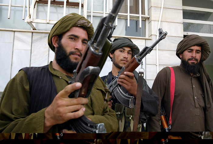 Taliban militants pose for the media after they join the Afghan government in Herat May 22, 2010. Twenty Afghan Taliban joined the Afghan government's reconciliation and reintegration programme in Herat on Saturday. REUTERS/Mohammad Shoiab (AFGHANISTAN - Tags: CIVIL UNREST POLITICS IMAGES OF THE DAY)