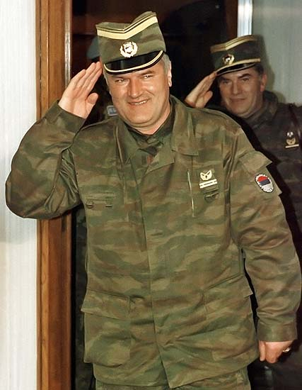 230206Bosnian Serb army Commander General Ratko Mladic (L) salutes followed by his senior aide General Milan Gvero (R) in Belgrade in this March 26,1993 file photo.  A close aide to top Bosnian Serb fugitive Ratko Mladic, general Gvero (67) who surrendered on Monday, faces war crimes charges of murder, prosecution and deportation of Bosnian Muslims during war conflict in former Yugoslavia. Gvero is being taken to Belgrade's airport for departure to The Hague U.N. Tribunal today. PICTURE TAKEN 26 MARCH 1993  REUTERS/Petar Kujundzic/Files-desk-mag