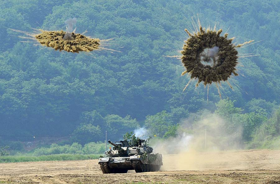 A South Korea's K1 tank fires smoke shells during a joint military drill between South Korea and the US in Paju near the inter-Korean border on June 8, 2011 aimed at deterring North Korea's military threat. Tensions on the Korea peninsula are high following two deadly border incidents last year which Seoul blames on its neighbour.  AFP PHOTO/JUNG YEON-JE