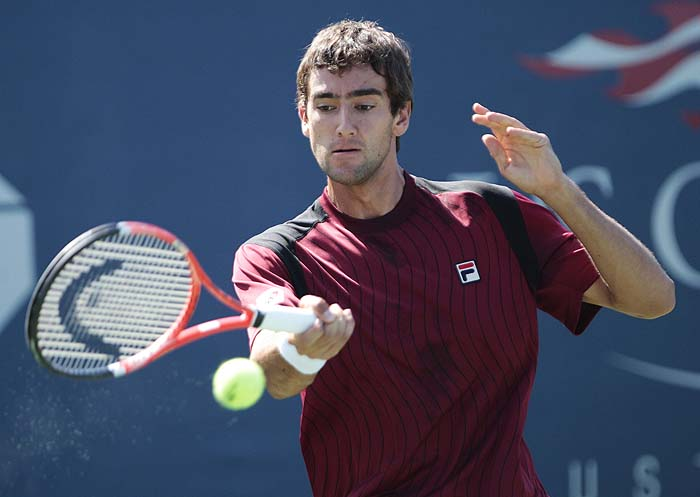 Marin Cilic of Croatia returns a shot to Illya Marchenko of Ukraine during the first round of the U.S. Open tennis tournament in New York, Monday, Aug. 30, 2010. (AP Photo/Frank Franklin II)