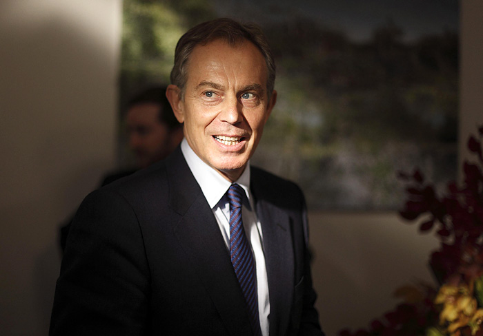 Former British Prime Minister Tony Blair arrives for an interview at the Blair Faith Foundation in central London November 17, 2009. Picture taken November 17, 2009.    REUTERS/Kevin Coombs    (BRITAIN POLITICS)