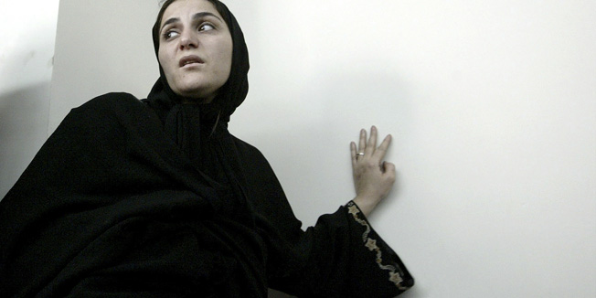 """In this photo taken on June 7, 2004, Shahla Jahed, enters the court room for her trial, in Tehran, Iran. Iran on Wednesday, Dec. 1, 2010, hanged a former soccer player's mistress _ known as a """"temporary wife"""" _ who was convicted of murdering her love rival, the player's wife, the official IRNA news agency reported. Shahla Jahed was hanged at dawn, after spending more than eight years in jail, IRNA said, in a case that has captivated the Iranian public for several years. (AP Photo/ISNA,Mehdi Ghasemi)"""
