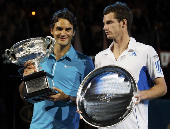 Roger Federer of Switzerland and Britain's Andy Murray pose with their trophys at the conclusion of the men's singles final at the Australian Open tennis tournament in Melbourne January 31, 2010. REUTERS/Daniel Munoz  (AUSTRALIA - Tags: SPORT TENNIS)