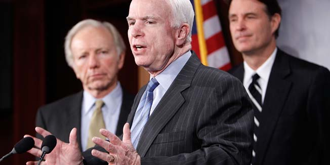 WASHINGTON - FEBRUARY 11: U.S. Sen. John McCain (R-AZ) (C) speaks as (L-R) Sen. Joseph Lieberman (D-CT), and Sen. Evan Bayh (D-IN) listen during a news conference on Capitol Hill February 11, 2010 in Washington, DC. The senators held a news conference to discuss Iran and proposed sanctions over human rights abuses.   Alex Wong/Getty Images/AFP== FOR NEWSPAPERS, INTERNET, TELCOS & TELEVISION USE ONLY ==
