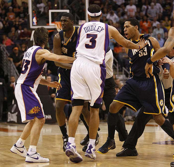 Phoenix Suns' Jared Dudley (3) and Steve Nash (13), hold back Indiana Pacers' Danny Granger (33) and Roy Hibbert after an altercation during the second half of an NBA basketball game Saturday, March 6, 2010 in Phoenix. The Suns won 113-105. (AP Photo/Matt York)